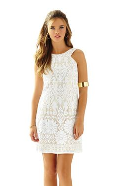 The Largo Shift is a white custom lace shift dress perfect for the bride to be  or future graduate. The neckline is flattering on any figure and highlights your gorgeous shoulders. With the gold lining peeking through from behind the sea    horses the need for accessories is minimal and the level of glamor much higher  than your average white lace dress.