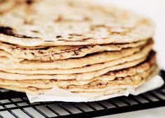 Thin soft shell paleo tortillas made in five minutes! No rolling out required. Make these soft gluten free blender by blending almond flour tapioca flour oil and milk. Pour batter onto a skillet and out comes the most beautiful and tasty grain free tor Paleo Tortillas, Coconut Flour Tortillas, Paleo Recipes, Low Carb Recipes, Whole Food Recipes, Paleo Flour, Beignets, Crepes, Paleo Banana Bread