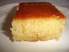 Greek Ravani or Semolina Cake with Syrup...I've made this before, with a different recipe, after I tried it at The Old Parthenon restaurant in Detroit's Greektown which used to serve one like this, simple. Now they load it with all kinds of stuff, which is a shame. It is best like this, trust me.