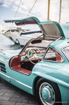 This Mercedes Gullwing is a cyan-coloured bird of paradise Vintage Sports Cars, Vintage Cars, Antique Cars, Bmw Classic Cars, Classic Mercedes, Classic Aston Martin, Mercedes Benz 300, Mercedes Maybach, Car Part Furniture