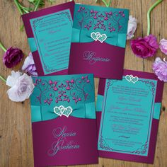 Wedding invitation suite in teal, plum purple, and magenta pink flowers with printed on ribbon, bow and jeweled double hearts.