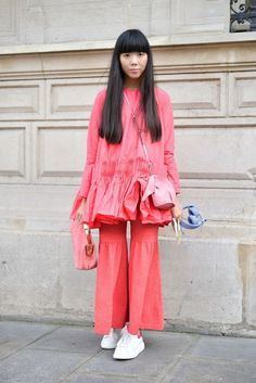 Susie Bubble in a salmon pink look with a Loewe elephant purse at the Chanel spring/summer 2016 haute couture show in Paris.