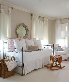 Pink and white girl's nursery boasts pale pink wall complementing ivory linen curtains hung over white roman shades and accented with banners. Pink Bedroom Design, Gold Bedroom Decor, Pink Bedroom For Girls, Big Girl Rooms, Bedroom Ideas, Grey Bedrooms, Bedroom Office, Girls Daybed Room, Nursery Daybed