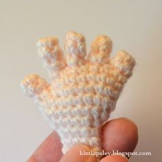 I'm writing up a pattern at the moment which requires hands. I've been asked before how I make hands with fingers for my amigurumis and, see...