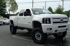 nice lifted  white Chevrolet Silverado