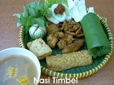 nasi timbel : rice, tofu, tempe, fried chicken, lalap (fresh raw veggies), sayur asem, sambal