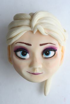 how to make elsa out of fondant - I don't think I could ever do this, but at least I can dream.