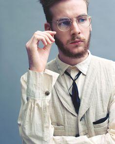 linen shawl collar vest, light cotton shirt with french cuffs, dark ribbon tie