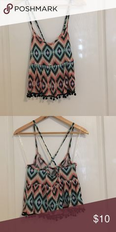 Strappy Crop Top Patterned crop top that crosses in the back. Cute pattern and colors perfect for spring or summer. Brand new with tags. Never worn. Tops Crop Tops