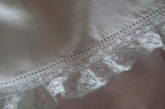 The Old Fashioned Baby Sewing Room: Beautiful lace pin-stitched onto dress.
