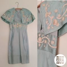 The most dressy silk blue mid century vintage dress with matching coat and built in capelet... breathtaking! !  https://www.etsy.com/listing/231140715/amazing-shiny-blue-50s-60s-regal-caplet