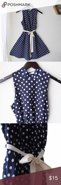 Polkadot Summer Dress Very simple, comes with a while fabric belt. Has 3 buttons on the backside for turtleneck fit on top. Tag says large but won't fit anyone bigger than a small. Monteau Dresses Mini