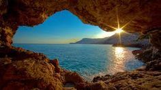 Sunrise Ocean Cave- Reminiscent of the band the Verve's album cover for A Storm In Heaven. What an amazing photo with the reflection of the sun on the ocean, the blue sky and ocean, and the outline of the cave. The Places Youll Go, Places To See, Beautiful World, Beautiful Places, Beautiful Sunset, Beautiful Moments, Beautiful Boys, Flora Und Fauna, All Nature
