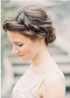 Low bun with a side braid and sequin flower at end of braid right where the bun starts, veil underneath?