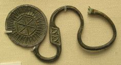 Latchet Fastener Irish dress pin Sixth or Seventh Century. From Newry, County Down, Northern Ireland. Celtic Clothing, Irish Clothing, Irish Jewelry, Queen Annes Lace, Anglo Saxon, Ancient Jewelry, Silver Dollar, British Museum, Fasteners