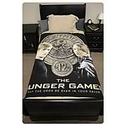 Hunger Games Movie Katniss and Peeta Polar Fleece Bed Throw -   Replace whatever boring blanket your mom got you over the holidays with this cool looking Hunger Games Movie Katniss and Peeta Polar Fleece Bed Throw! Pretty much guaranteed not to suck due to the awesome District 12 symbol behind an image of Jennifer Lawrences Katniss Everdeen and Josh...