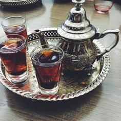 """Need to get my hands on a tea set like this!! We were way too excited by this beauty. We had traditional black tea with mint (which they forgot to bring till after the photo was taken). Fun fact: my dad, like a true Egyptian sent back the first pot of tea because he said it wasn't strong or hot enough and told the waiter """"sorry, but I'm a tea connoisseur"""". #funny1dad"""