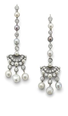 A pair of natural pearl and diamond ear pendants  Each designed as an old brilliant-cut diamond and natural pearl line suspending a similarly cut diamond and natural pearl fan and three row tassel, length 7 cm.