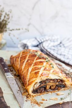Vegan Mushroom Wellington // Wellingtons are the most wonderful when made with mushrooms. If you need proof, make this exquisite recipe. The crusty outside and savory, delectable inside create an excellent harmony, that will earn you praises, compliments and happy bellies. | The Green Loot ... #vegan #veganrecipes #veganchristmas #veganchristmasdinner #christmasrecipes