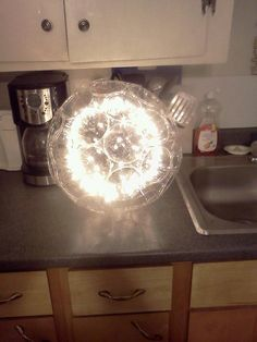 another sparkle ball made with solo cups and clear chritmas lights