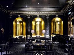 Black Gold Room Beaufort Bar, Savoy Hotel, London - The Beaufort Bar exudes theatrical glamour. In an Art Deco interior of jet-black and burnished gold décor, the bar is all about champagne, cocktails and cabaret. It offers one of London's most exte… Art Deco Hotel, Hotel Decor, Savoy Hotel London, London Hotels, Design Hotel, Restaurant Design, Dark Restaurant, Dark Interiors, Colorful Interiors