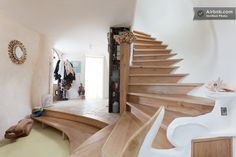 Interior staircase of a Gaudi-inspired houseboat in the Netherlands.