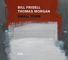 Small Town presents guitarist Bill Frisell and bassist Thomas Morgan in a program of duets the poetic chemistry of their playing captured live at New York s hallowed Village Vanguard. Frisell made his debut as a leader for ECM in 1983 with the similarly intimate In Line. The guitarist's rich history with the label also includes multiple recordings by his iconic cooperative trio with Paul Motian and Joe Lovano culminating in Time and Time Again in 2007. Small Town begins with a tribute to…