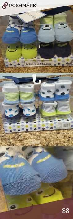 """CUTIE PIE Boxed Socks Set 0-12months This gift box of 4 pairs of baby/crib socks has been knocking around the closet too long. Cute little """"monster"""" socks in blues and greens fit 0-12 months. Super cute, never opened, new old stock. Packaging looks nice. Original price tags were removed. Bargain. I ship fast. Cutie Pie Accessories Socks & Tights"""