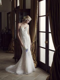 Carnation is a strapless, form fitting, fit-n-flare gown that boasts a sumptuous combination of beaded and embroidered tulle over iridescent organza with sleek ...