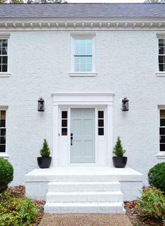 White brick house exterior with pastel front door - Young House Love. Colonial House Exteriors, Painted Brick Exteriors, White Exterior Houses, Painted Brick Houses, Painted White Brick House, Paint Brick, White Bricks, Exterior Door Trim, Concrete Houses