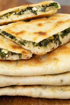 Gozleme is popular a Turkish flatbread with fillings. This is an easy recipe to make it at home from scratch with spinach and feta cheese filling. Recipes cheese Spinach and Feta Gozleme - El Mundo Eats Feta Cheese Recipes, Spinach And Cheese, Spinach Feta Pie, Spinach Bread, Frozen Spinach, Turkish Recipes, Greek Recipes, Vegetarian Recipes, Cooking Recipes