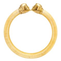 1930 LACLOCHE Ivory and Gold Bangle Bracelet, accented by a pair of sphinx.