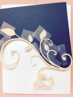 TIP:Insert the cut flourish into the TOP or BOTTOM section then scotch tape it in on the BACK before gluing it to card front.