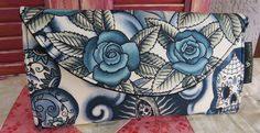 Sugar Skull or Rose Wallet in Blue Tattoo  Perfect wallet or large enough to use as a clutch. Beautiful blue tattoo print from Alexander Henry on the exterior and black durable fabric on the interior. Pocket behind the zipper pouch is large enough to hold a cell phone securely.