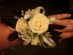 White Rose Wrist Corsage With Black And Silver Accents.