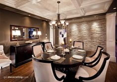 This is pretty much everything I love in one dining room!  Love the stone wall, the coffered ceiling, the wood trimmed dining chairs the ORB light fixture, the touches of chrome for sparkle....perfect.