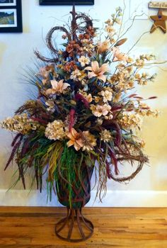 Flowers I made for a country wedding, I used some tattered angels glimmer mist old lace and baseboard tiger Lilly to give the flowers to color needed for wedding theme !