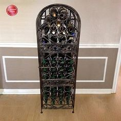 Wine Enthusiast Renaissance Wrought Iron Wine Jail: Guard your wine in grand style. Ornate scrollwork with antique bronze finish evokes the artistry of the Renaissance, a fitting setting for your wine. Cake Decorating Airbrush, Wine Rack Cabinet, Wine Racks, Wine Leaves, Best Amazon Products, Types Of Wine, Wine Storage, Storage Ideas, Decorating Tools