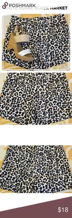 White House Black Market Shorts These sexy animal print shorts are a fun addition to your wardrobe. They can be worn in the summer with wedges or in the off season with black tights. They have real pockets in the front and faux pockets in the back. They also have wide belt loops if you would like to add a fun belt. Waist=15 1/2 Length=12 3/4  98%cotton 2%spandex EUC EXCEPT for tiny spot or two in the front that actually blend in (see last pic) White House Black Market Shorts