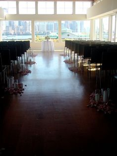 Wedding ceremony with candles and petals at Maritime Parc Jersey City by Limelight Floral Design, Hoboken NJ