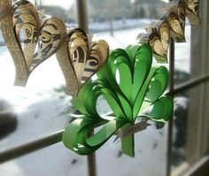 St. Patrick's Day Party: Shamrock garland of hand cut hearts. Easy to DIY! Might try this with thick felt.