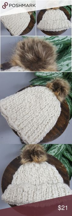 Slouchy Beanie with Faux Fur Puff Ball In like new condition.  Soft and cozy slouchy beanie with faux fur puff. Accessories Hats