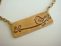 Sweet bronze bird necklace.