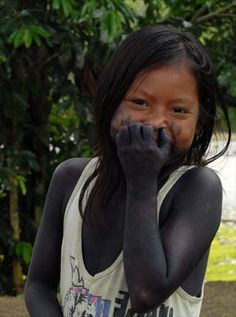 Shy smile of a indigenous Colombian .