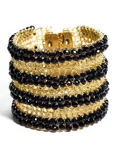 "Check out Lockerz Shop's ""Lavish Beaded Bracelet Gold Black"" decalz @Lockerz http://lockerz.com/d/20011802"