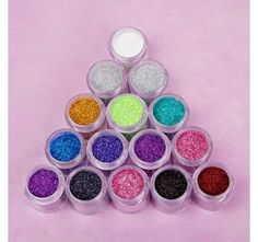 Bh Cosmetics' collection of sparkling loose glitter makeup comes in an amazing array of shades, from radiant reds to dazzling purples. Incredibly versatile, they can be used to add a twinkle to your eyes, a shimmer to your lips or as a face highlighter! To apply, pat onto skin with a damp brush and let dry.