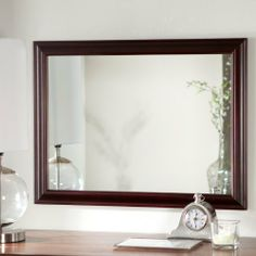 Mateo Wall Mirror - 23.6W x 31.5H in. by Decor Wonderland. $189.99. Wood frame with rich mahogany finish. Double-coated silver metal backing and seamed edges. 31.5H x 23.5W x 1D inches. Ready to hang with included mounting hardware. Crafted from beveled 3/16-inch glass. The Mateo Wall Mirror is a simple way to add light, elegance, and interest to any room. Hang this generously-sized mirror vertically or horizontally to best suit your space. The solid wood frame is finishe...