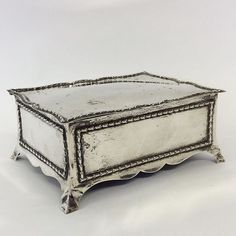 Lot 60 is a stylish silver jewellery box with wavy edge on bracket feet. London. By WC. Est. 120 - 150. For #SALE in our #Silver #Jewellery and #Furniture #Antiques #Auction on Thursday 22nd February! Inclusive of #watches #collectables #paintings and #art#February22 #whittonsauctions #whittons#honiton #pin