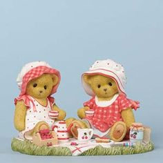 "Fig Bears/Cherries Sandw Abigail and Amelia enjoy a delightful picnic in the park, complete with tea, bread, and cherry jam. Their cheerful dresses display bright and colorful patterns. Matching sun bonnets complete their very ""cherry"" look."