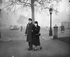 The Great Smog of London of 1952: A young couple pictured wearing their home-made smog masks on their way to work in London during the Great Smog